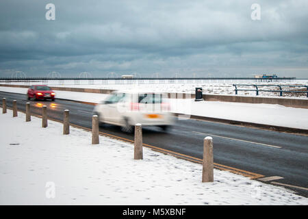 Southport, Merseyside, UK 27th Feb, 2018. UK Weather. First snow in the resort for 8 years. Further frequent snow - Stock Photo