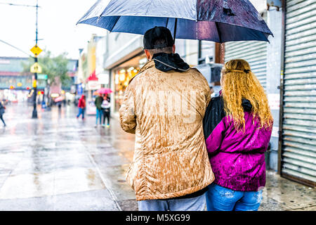 Bronx, USA - October 29, 2017: Road street in Fordham Heights center with stores, New York City, NYC during day, - Stock Photo
