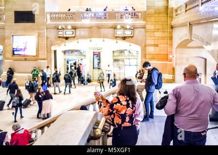 New York City, USA - October 29, 2017: People walking in Grand Central Station taking pictures in NYC main hall, - Stock Photo