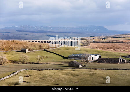 Ribblehead viaduct and Pen-y-ghent peak (on horizon), Yorkshire Dales National Park, UK - Stock Photo