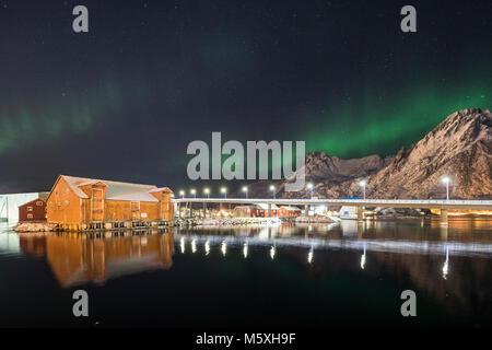 Northern lights, Aurora Borealis over Svolvaer, townscape, harbour with illuminated bridge, Svolvaer, Austvågøy, - Stock Photo