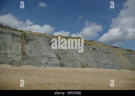 Soft Grey Fossil Rich Mudstone Cliffs Along Charmouth Beach, West Dorset, UK. Jurassic Coast World Heritage Site, - Stock Photo