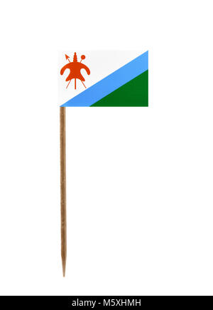 Tooth pick wit a small paper flag of Lesotho - Stock Photo