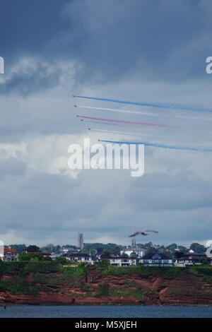 The RED ARROWS, RAF Aerobatic Team with Union Jack Smoke On. Torbay Airshow, Summer, 2016. From Paignton, English - Stock Photo
