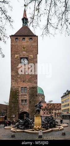 The White Tower (built circa 1250, part of the 2nd fortification line around Nuremberg) and the Ehekarussel Fountain, - Stock Photo