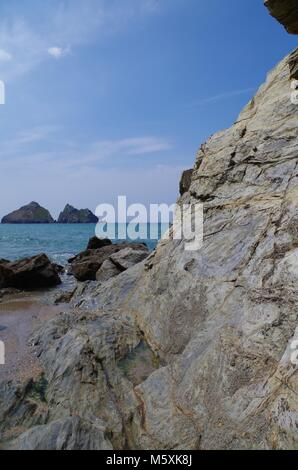 Gull Rocks Island, offshore Holywell Bay, North Cornwall, UK. On a Sunny Summef Day with Blue Sky and Turquoise - Stock Photo