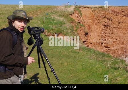Young Handsome Birdwatcher with Leica Spotting Telescope. On the South West Coast Path at Budleigh Salterton, East - Stock Photo