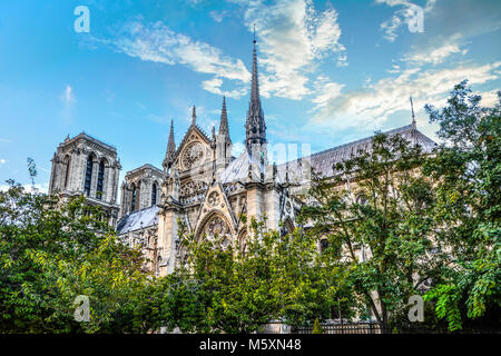 The ornate gothic architecture and spires on the side of Notre Dame Cathedral, Paris France on a sunny summer day - Stock Photo