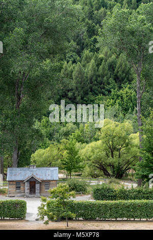 Abandoned old wooden house in deep forest - Stock Photo