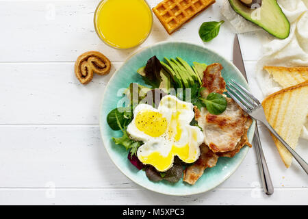 Full  English breakfast - fried egg, fried bacon and orange juice. - Stock Photo