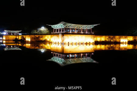 The pavilions of Anapji Pond at night reflected in the water in Gyeongju, South Korea. - Stock Photo