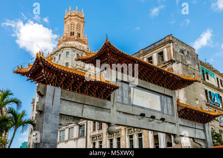 Abandoned chinatown arch and old slums in the background, Havana, Cuba - Stock Photo