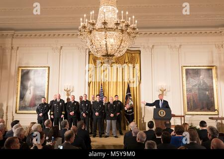 U.S President Donald Trump presents the Medal of Valor to police officers during a ceremony in the East Room of - Stock Photo