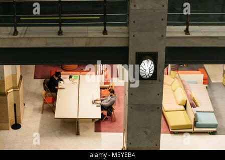 Madrid, Spain - November 3, 2017: Interior view of colourful lounge for reading and networking in Centro Cibeles - Stock Photo
