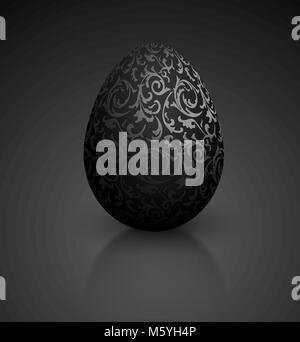 Black color mat realistic egg with metallic floral pattern. Isolated on black background with reflection. Vintage - Stock Photo