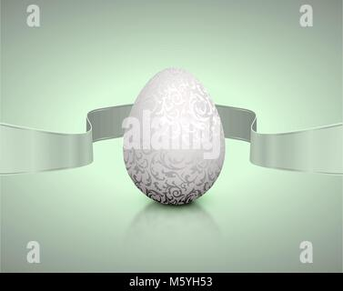White natural color realistic egg with silver metallic floral pattern and grey winding tape. Light background with - Stock Photo