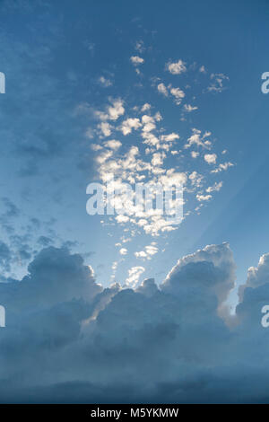 Sunlit altocumulus clouds and blue sky - Stock Photo