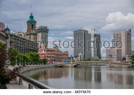 The classical style General Post Office building at 395 Tiandong Road on Suzhou Creek with the Sichuan Road Bridge - Stock Photo