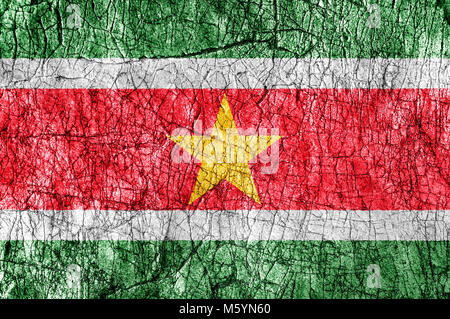 Grudge stone painted  Suriname  flag - Stock Photo