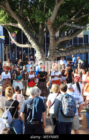 Tourists watching live local music and dancing on the Victoria & Alfred waterfront, in Cape Town, in the Western - Stock Photo