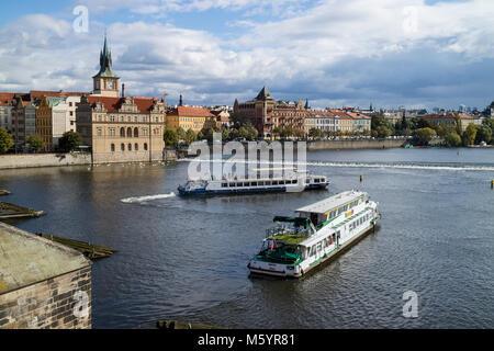 Prague; Czech Republic - October, 6, 2017: Classic Czech buildings and Smetana Museum along the Vltava River in - Stock Photo