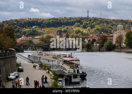 Prague, Czech Republic - October 8, 2017: Launches and tourists on the Moldau river in Prague in autumn with the - Stock Photo