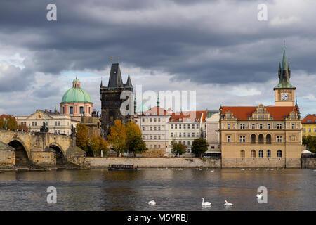 Prague, Czech Republic - October 9, 2017: Classic Czech buildings and Smetana Museum along the Vltava River in Prague - Stock Photo