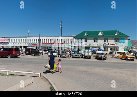Animation in a street, Kochkor village, Road to Song Kol Lake, Naryn province, Kyrgyzstan, Central Asia - Stock Photo