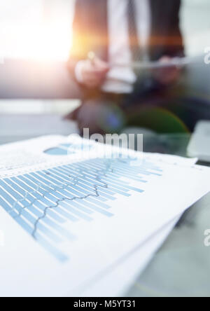 financial graph on the desktop. business background. - Stock Photo