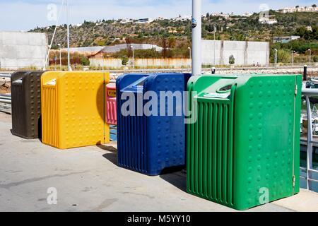 Recycling bins in the marina, Albufeira, Algarve, Portugal, Europe. - Stock Photo