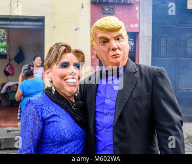 Cuidad Vieja, Guatemala - December 7, 2016: Participants wear Donald Trump & Hillary Clinton masks in Virgin of - Stock Photo