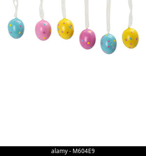 colorful Easter eggs on a rope. wooden wall. vivid juicy colors of Easter eggs. - Stock Photo