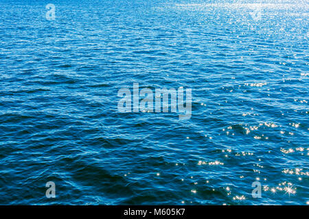 Beautiful sea surface background, sun shines on the sea surface, sun reflection on water - Stock Photo