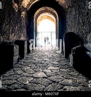 Entrance tunnel to The Amphitheatre of Pompeii, Italy. - Stock Photo