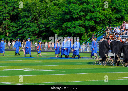 JUNE 17 Sayrevielle NJ USA: Graduates are walking the line to get a diploma and selective focus. - Stock Photo