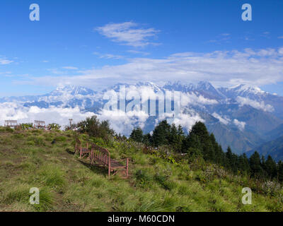 Benches on Poon Hill - one of the most visited Himalayan view points in Nepal, view to snow capped Himalaya - Stock Photo