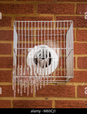 Ipswich, England. Icicles form on boiler vents as the elderly try to keep warm when 'The Beast From The East' cold - Stock Photo