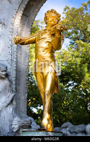 The golden statue, of Johann Strauss II (The Waltz King) in Stadtpark, Wien, Vienna, Austria. - Stock Photo
