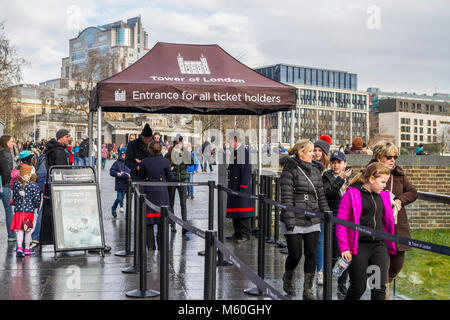 Tourists buying tickets, visiting the Tower of London, top London sight seeing attraction, UK - Stock Photo