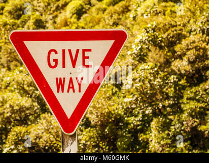 Give Way Triangular Shaped street traffic sign on the rural road area in the nature of New Zealand scenic driving - Stock Photo