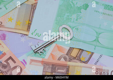 safe key on Euro banknotes, safety for the money - Stock Photo