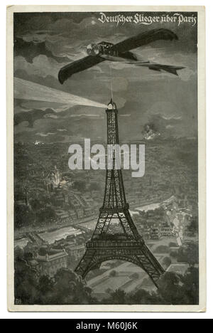 Old German postcard military airplane Taube over Paris, the Eiffel tower on the background of explosions and fires. - Stock Photo