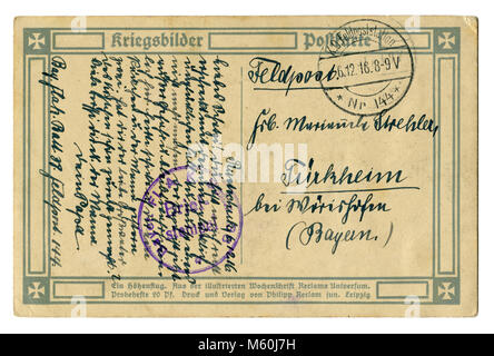 Back of Old German world war one postcard (M60J7H) letter written in black ink with postmark of the military unit - Stock Photo
