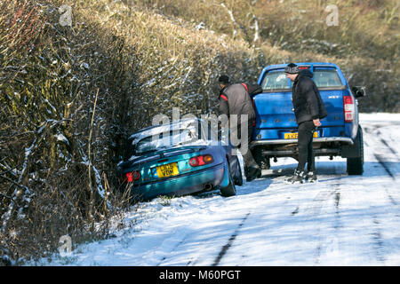 Burscough, Merseyside, UK.  27th Feb, 2018. UK Weather.  Slipping on ice, winter Car accident, road, snow, cold, - Stock Photo