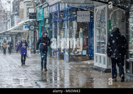 Ilkley, West Yorkshire. 27th Feb, 2018. UK Weather: People in Ilkley,  heads bowed, dressed in winter clothing with - Stock Photo