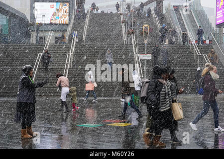 People caught in heavy snowfall at Stratford in London, England, United Kingdom, UK - Stock Photo
