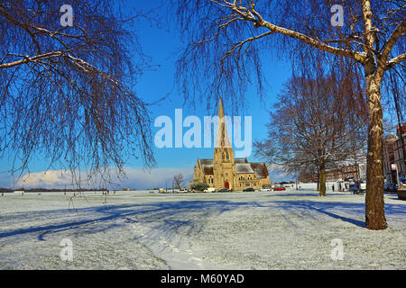 London, UK. 27th February 2018. All Saints Church in the winter sunshine during snowy weather conditions in Blackheath, - Stock Photo