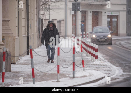 Krakow, Poland. 27th Feb, 2018. A man walks during a low temperature day in Krakow. Credit: Omarques 27022018  12 - Stock Photo