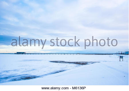 Southport, UK. 27th February, 2018. UK Weather 27 Feb 2018. Snow on Southport Beach & Pier, England UK As cold weather - Stock Photo