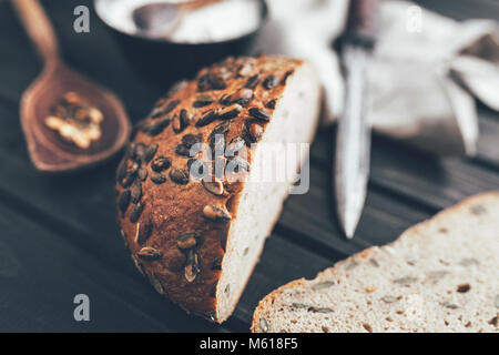 Delicious freshly baked bread on wooden background - Stock Photo